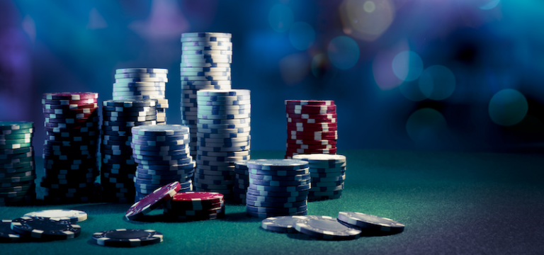 Image shows a gambling table of someone going all-in with casino chips.